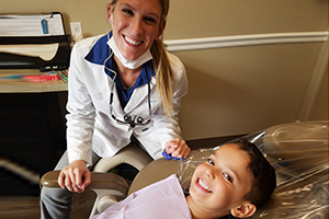 Life Smiles Dental Care doing dental surgery for kids