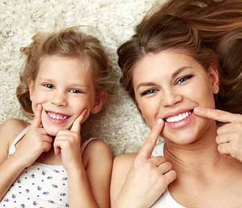 Image of mother & daughter smilling, with white teeth